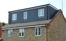 Dormer loft conversion with bi-fold doors. Upvc Windows, Dormer Windows, Loft Conversion Plans, L Shaped House, External Cladding, House Cladding, Roof Extension, Loft Room, Planning Permission
