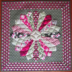 """Fabulous fabrics from Joel Dewberry, a traditional block using the EZ Dresden ruler = a great little table topper.        8"""" Dresden wedge..."""