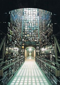 Holocaust Museum - Washington D.C.    I cried like a little baby in here. Before you get on the elevator to see the museum, they give you a passport from this endless wall of passports.  In the passport is someone's story from the holocaust..I picked one and opened it up,  and the woman had the same birthday as me. She ended up dying at Auschwitz.
