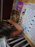 using Montessori tongs......