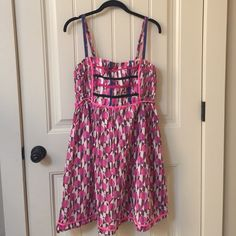 FREE PEOPLE sundress dress summer pink SHARP Trendy and popular brand FREE PEOPLE. Elastic in back. The only issue is see picture number four, the little pink cord is ripped off and hanging, still wearable but I'm not handy with a needle and can't repair it. Thus, the reason for the low price. This was expensive! Size 10. Colors are pink, purple, wine and cream. Cute as can be on!!! Make me an offer Free People Dresses Mini
