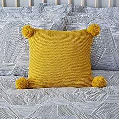 Knitted cushion in ochre, finished with pom pom detail (Dunelm) Knitted Cushions, Knitted Throws, Pom Pom Cushions, Mustard Bedroom, Yellow Cushions, Cushion Inserts, Cushion Covers, Craft Storage