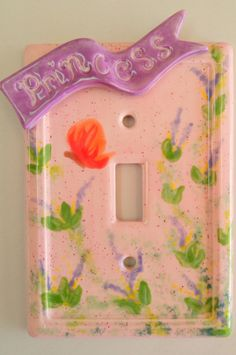 Light switch plate painted with princess tag-along attached.