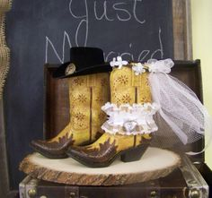 Large boots, great centerpiece for bride and groom's table. Complete with wooden tree slab. $68.00