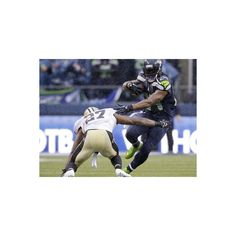 NFL Playoffs 2014: Jan 11, 2014 - Saints vs Seahawks - Marshawn Lynch... ($50) ❤ liked on Polyvore featuring home, home decor, wall art, nfl posters, photo wall art and photo poster