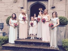 The beautiful bridesmaids ready to walk Olivia down the aisle
