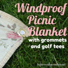Windproof your picnic blanket with grommets and golf tees.
