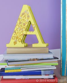 Can humble wooden letters become the belles of the bookshelf? If you can dream it, you can stencil it!