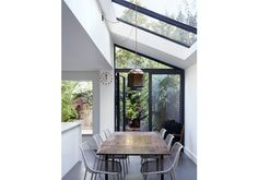 We remodeled the existing kitchen space by adding a glazed lean to extension, with a zinc roof. A glass box forms a window seat. Glass Extension, Rear Extension, Zinc Roof, Contemporary Barn, Victorian Kitchen, Glass Boxes, House Extensions, Patio, New Homes