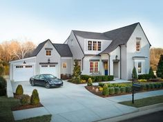 The design of HGTV Smart Home 2014 is inspired by homes along the English countryside, namely Tudor homes found in suburban neighborhoods of Nashville.  Sloping roof lines are a key design feature of this architecture.  PS...that brand new Lincoln MKZ in the driveway is part of the package for the lucky winner --> http://hg.tv/v803