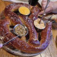 Huge soft pretzel with beer cheese spicy mustard and nacho cheese from Mitten Brewing Grand Rapids.