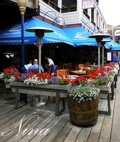 Great outside / outdoor / pation café / restaurant curb appeal using flowers and their colors to achieve it!