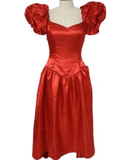 Early 80s -No Label- Womens ruby red sheeny satin polyester short sleeve floor length totally 80s cocktail or prom dress. Extra puffy sleeve... :) I wore this exact style only the material was Royal Stewart Tartan! sigh... Loved that bridesmaid dress!! (that was the *only* one I ever loved though..lol! 80s/90s had some really awful ones.)