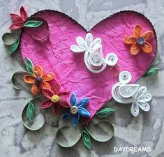 I quilled this valentine for a scrap book cover page that I was asked to make. I was given a general idea of how the pag...