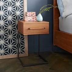 http://www.westelm.com/products/nash-metal-wood-curved-nightstand-h1519/?pkey=cnightstands  