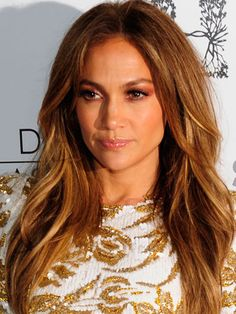 Jennifer Lopez's long, layered hair is her signature style.