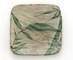 Square dish with bamboo grass design, late 18th to early 19th century. Kyoto workshop, Kenzan style. Edo period. Earthenware with iron pigment and enamel under transparent lead glaze. H: 1.9 W: 19.1 cm. Kyoto, Japan.