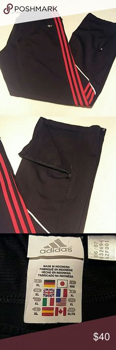 Men's Addidas Sweatpants Men's black Adidas sweatpants drawstring  elastic around the waist.  Red stripes, two front packets. Zippers at the bottom orange outer side of the pants legs. Size XL. In excellent condition. Adidas Pants Sweatpants & Joggers