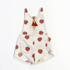 This lovely little strawberry romper is so playful in its print and is perfect for your little darling this spring and summer.  It has been created with beautiful vintage linen. The waistband is elastic and the shoulder straps tie down at the back of the waistline for a comfortable and variable fit. This is a limited edition piece.Torso length from bottom seam to neckline9-12 months - 14 inches12-18 months - 14.5 inches18-24 months - 15 inches2T - 15.5 inches3T - 16.5 inches4T - 17…