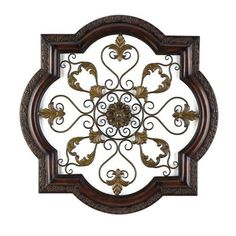 "One of my clients has cathedral ceilings in her kitchen and chose this to hang above her cabinets. ""Stunning open scrollwork metal wall medallion has a rich brown finish with copper highlights. 30 x www. Pots, Stairway Decorating, Copper Highlights, Home Catalogue, Medallion Wall Decor, Tuscan Decorating, Celebrity Houses, Metal Wall Decor, Ideas"