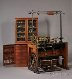 SCIENCE, TECHNOLOGY & CLOCKS - SALE 2623M - LOT 232 - HOLTZAPFFEL & COMPANY ROSE ENGINE LATHE NO. 1636 AND CABINET OF ACCESSORIES, LONDON, 1838, THE MAHOGANY BENCH WITH SIX INCH CENTER LATH - Skinner Inc