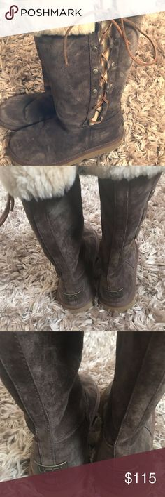 Ugg Boots w/ Lace-up and Fur Detail - Size 7 One pair of gently worn tall Ugg boots with lace-up and fur detail (women's size 7). These are in perfect condition! Message me with any questions. UGG Shoes Winter & Rain Boots