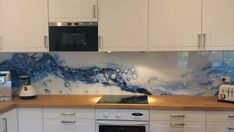 Recently we completed a splashback with a striking digital image printed on the back of the glass. We were able to use an image sourced and provided by the customer, which was then scaled and measured to suit the space. Calming blue was a nice. Blue Backsplash, Kitchen Backsplash, Kitchen Countertops, Kitchen Mosaic, Glass Kitchen, Printed Glass Splashbacks, Nagellack Design, Glass Printing, Kitchen Wallpaper