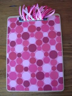 how to make decorative clipboards...I like the polka dot but not the top loose ribbons. Would also put my last name initial on the back of it