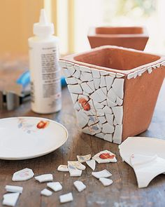 Bedecking small household objects, such as these terra-cotta planters, with china fragments adds a delightfully unexpected flourish -- and requires only a few plates per pot.
