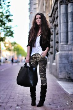 Black jacket. White top. Camo Jeans. Black boots.