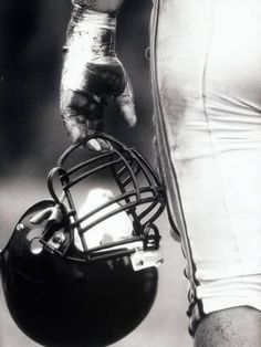 Angle View of An American Football Player Holding a Helmet Photographic Prin.Low Angle View of An American Football Player Holding a Helmet Photographic Prin. Football Senior Pictures, Football Poses, Sports Pictures, Senior Photos, Senior Portraits, Football Art, Football Season, Football Tattoo, Football Banquet