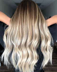 We get it, you want to change things up as winter draws near, yet you don't want to go all the way over to the dark side. A balayage ombre combo will keep your warmth while incorporating shadowy tones up top. #blonde #blondeombre #ombre #balayage #fallhair #hairtrends