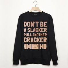 Don't Be A Slacker Pull A Cracker Christmas Sweatshirt. Shop Christmas Jumpers now.
