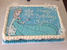"Frozen Elsa Buttercream Sheet Cake with white chocolate snowflakes and hard candy ""ice crystals"" on the sides."