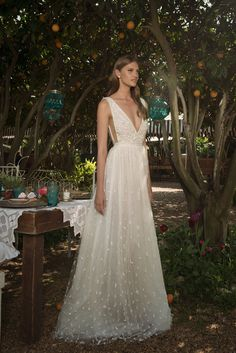 Beautiful backless wedding dress with deep V neckline from Eisen Stein 2016 Collection - see the rest of the collection on www.onefabday.com