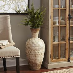 Once used for shipping and storing wine, the classic amphora vase boasts a proud heritage dating back to at least 6000 B.C. Our decorative Bella pays tribute with its authentic shape, handcrafted terracotta construction and characteristic markings. Use alone as a timeless and versatile accent, or fill with dried stems and flowers.