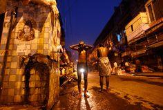 A man takes a bath along the streets of Delhi. (Reuters)