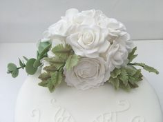 White roses and eucalyptus on a white single tier wedding cake #whiteonwhitewedding #whiteweddingcake #whiteroses #handmadesugarroses #weddingcakesmanchester Fondant Cake Toppers, Fondant Cakes, Beautiful Cakes, Amazing Cakes, Owl Cakes, White Roses Wedding, Cake Decorating Classes, Coconut Bars, Cookie Gifts