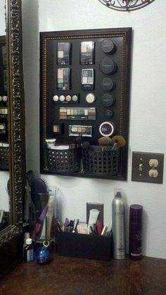 make-your-own-magnetic-makeup-board-cheap-frame by ailjkic,I would use a piece of sheet metal that you can get at any lowes or home depot and have it cut to the side of your frame. If you want it black you can paint it. also use heavy duty magnets that you use hot glued to the back of makeup to hold it on. For the baskets I might use the hooks made by 3m with adhesive on the back.