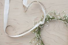 We have seem some amazing flower girl crowns lately so we decided it was about time we showed you how to make your own! This wedding started it, with these these adorable flower girl crownsand we have been thinking about them ever since. For this tutorial we wanted to keep it basic with a rustic twist but you could add whatever flourishes you wanted to this to fit it in with your wedding theme. To make it more vintage you could ass lace to the bow instead of the burlap rope. To dress them…
