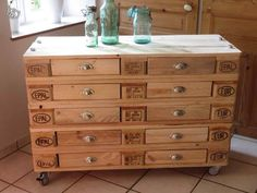 Magnificent storage or tool cabinet made from pallets and fabricated drawers.