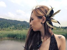 One of a kind, gold feather ear cuff.  *Brass wire*  *High quality lamb leather* *Beautiful bleached gold natural feathers*  *Black feathers*