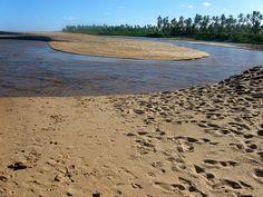 Where the river meets the ocean in Praia de Imbassai, Bahia #Brazil