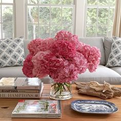 coffee table styling for family room - image source unknown