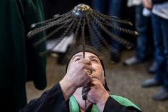 A Kosovo dervish, adept of Sufism, a mystical form of Islam, pierces his neck with a needle during a ceremony in a prayer room in Prizren during Newroz celebrations March 22, 2018. — AFP pic