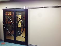 2. This eccentric showroom entrance is completed using Crowder Round Track with top mount hangers.