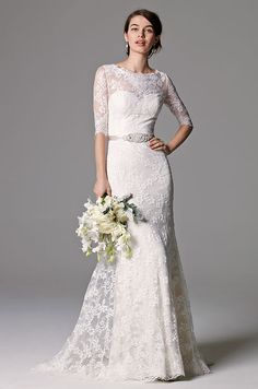 This gown of Ballerina Lace is timeless with three-quarter sleeves and a lace illusion scoop neckline. Watters, Fall 2015
