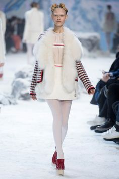 Moncler Gamme Rouge, Look #18 Fur for the revers of a knit cardigan jacket.