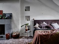 Bedroom with purple rug and storage niches