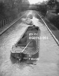 """Captioned: """"Mixed train heads west through Regents Park in wartime London""""  #london #canal #regents #park #barge #wideboat #coal #house #gas #zoo #tug"""